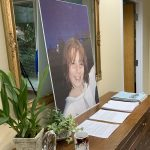 picture of plaintiff as child and table with lawsuit documents